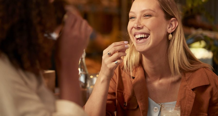 Woman eating macadamia product